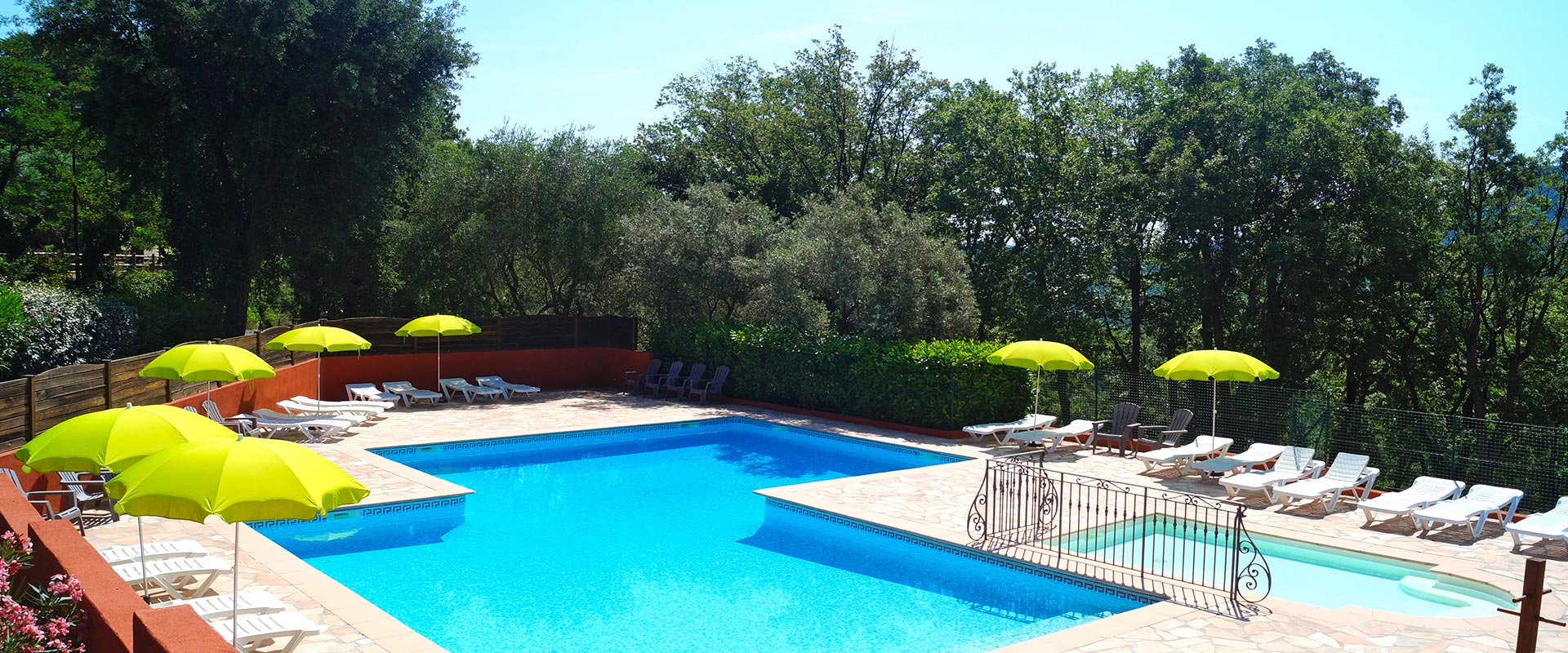 The swimming pool with sun loungers and parasols